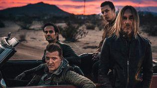 "L'équipe de ""Post Pop Depression"", le prochain album d'Iggy Pop avec Josh Homm (en bas à gauche), Dean Fertita et Matt Helders (derrière Iggy).  (Loma Vista)"