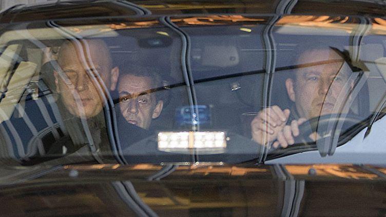 L'ancien président Nicolas Sarkozy arrive au Pôle financier du palais de justice de Paris, le 16 février 2016. (THOMAS SAMSON / AFP)