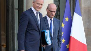 Le ministre de l'Economie et des Finances Bruno Le Maire et le ministre de l'Education nationale Jean-Michel Blanquer à l'issue du Conseil des ministres, le 21 octobre 2019 à l'Elysée à Paris (JACQUES DEMARTHON / AFP)