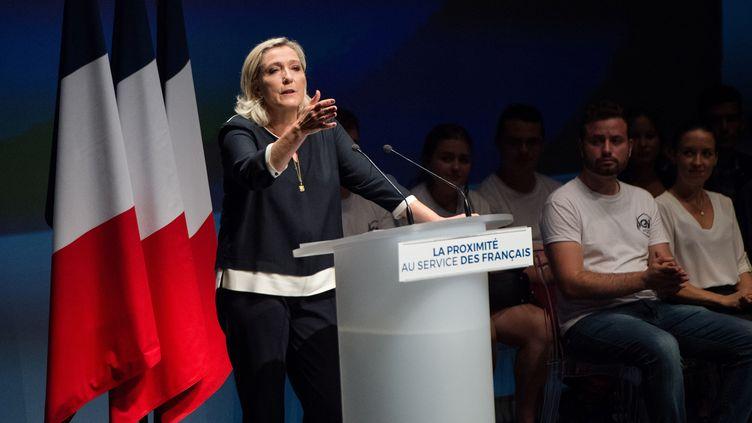 La présidente du Rassemblement national, Marine Le Pen, lors de l'université d'été du parti, le 15 septembre 2019 à Fréjus (Var). (CLEMENT MAHOUDEAU / AFP)