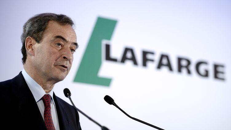 Bruno Lafont, l'ancien patron de Lafarge, lors d'une conférence de presse à Paris le 7 avril 2014 à Paris. (FRANCK FIFE / AFP)