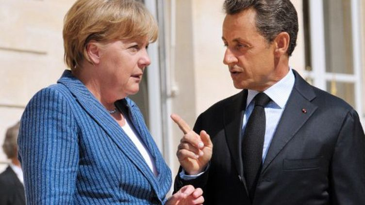 AMerkel et Sarkozy se rencontreront dimanche pour parvenir à un accord sur la recapitalisation des banques. (PHILIPPE WOJAZER / AFP)