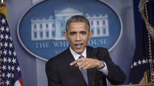 Le président américain Barack Obama, le 19 décembre 2014 à Washington (Etats-Unis). (BRENDAN SMIALOWSKI / AFP)