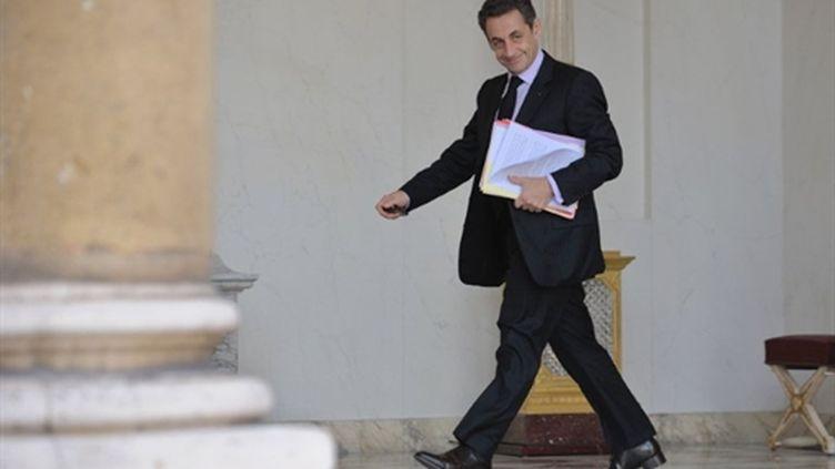 Nicolas Sarkozy arrive à l'Elysée, le 16 mars 2011. (AFP - Eric Feferberg)