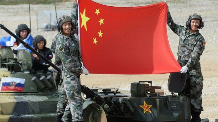 La Chine abandonne peu à peu son principe de non-ingérence dans les affaires d'un pays étranger. C'est particulièrement le cas en Syrie où Pékin a signé un accord de coopération inter-militaire avec le régime de Bachar al-Assad. (MAKSIM BLINOV / SPUTNIK / AFP)