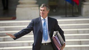 Le ministre du Budget, Jérôme Cahuzac, quitte l'Elysée (Paris), le 6 juin 2012. (FRED DUFOUR / AFP)