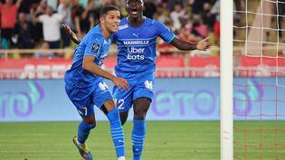 Amine Harit et Bamba Dieng lors du match de Ligue 1 entre Marseille et Monaco, au stade Louis II, le 11 septembre 2021. (VALERY HACHE / AFP)