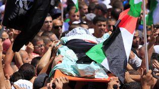Les funérailles de l'adolescent palestinien tué, le 4 juillet 2014 à Jérusalem-Est. (ELOISE BOLLACK / CITIZENSIDE.COM / AFP)