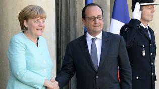 Angela Merkel et François Hollande à l'Elysée, le 6 juillet 2015. (BERTRAND GUAY / AFP)