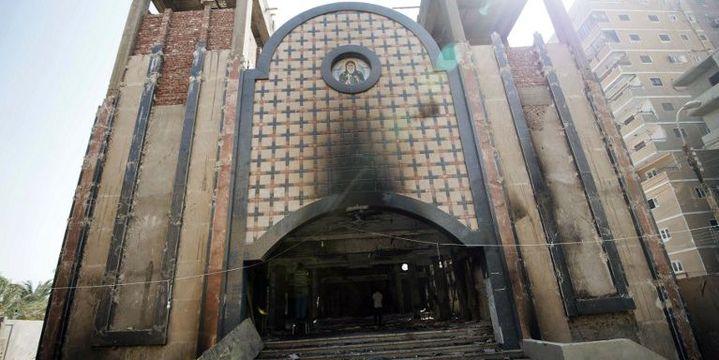La façade de l'église copte Amba Moussa, incendiée en août 2013. (GIANLUIGI GUERCIA / AFP )
