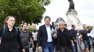 Jean-Luc Mélenchon, député de La France insoumise, arrive à la manifestation de la place de la République, à Paris, organisée pour dénoncer le projet de réforme du Code du travail, mercredi 12 juillet 2017. (BERTRAND GUAY / AFP)