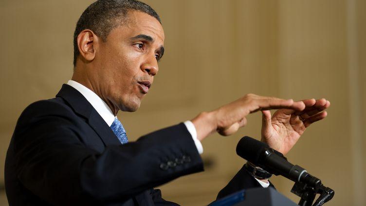 Barack Obama, le président américain, s'exprime durant une conférence de presse à Washington, le 14 janvier 2013. (JIM WATSON / AFP)