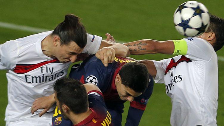 Parisiens et Barcelonais au Camp Nou, le 10 avril 2013 (JOSE JORDAN / AFP)
