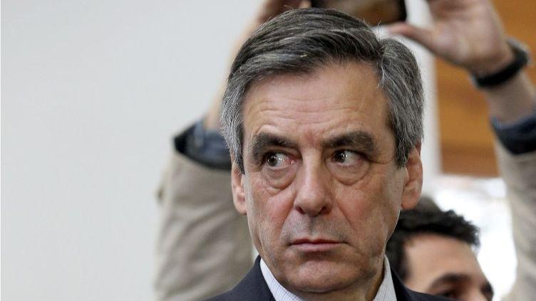 L'ambiance pas à la détente, d'après le député Pierre Lelouche, qui s'est vu arracher le micro des mains alors qu'il tentait de prendre la parole. (FRANCOIS NASCIMBENI / AFP)