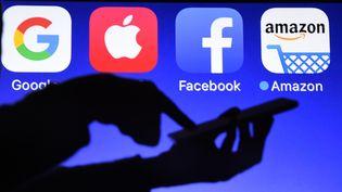 Les Gafa (Google, Apple, Facebook et Amazon) sur un smartphone. (DAMIEN MEYER / AFP)