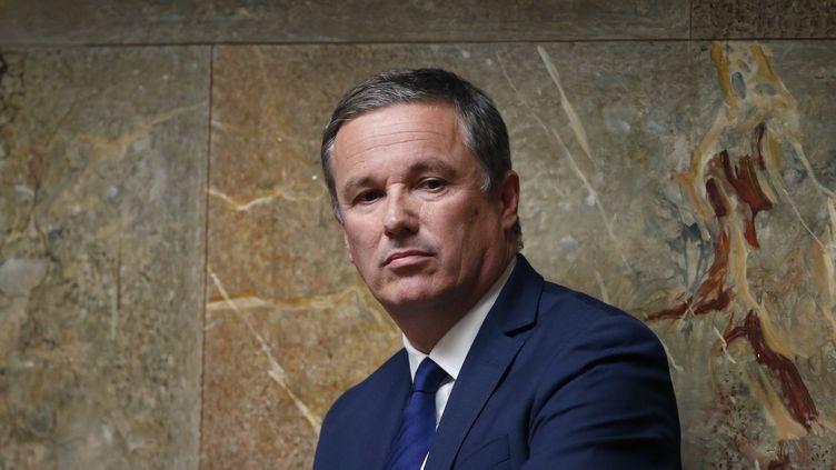 Nicolas Dupont-Aignan à l'Assemblée nationale, le 15 juillet 2014. (CHARLES PLATIAU / X00217)