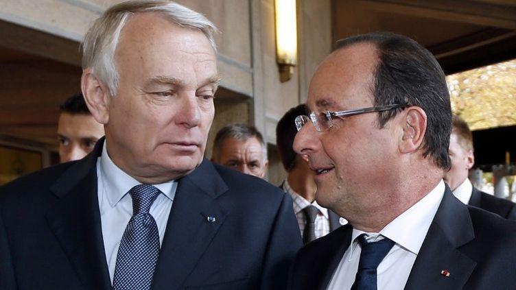 Le président François Hollande et le Premier ministre Jean-Marc Ayrault à Paris le 20 septembre 2013. (CHARLES PLATIAU / AFP)