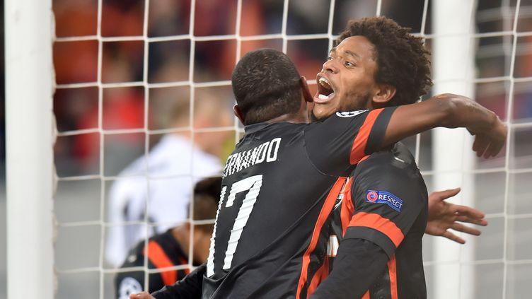 Luiz Adriano et les siens sont en 8e (SERGEI SUPINSKY / AFP)