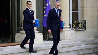 Le ministre du Budget, Gérald Darmanin, et le ministre de l'Economie, Bruno Le Maire, le 12 juillet 2017, à l'Elysée. (MARTIN BUREAU / AFP)