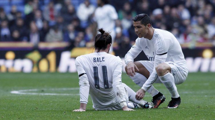 Gareth Bale, blessé, et Cristiano Ronaldo a ses côtés (GUILLERMO MARTINEZ / NURPHOTO)