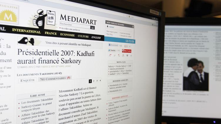 Le site internet Mediapart a publié le 28 avril une note libyenne accusant Sarkozy d'avoir été financé par Kadhafi. (KENZO TRIBOUILLARD / AFP)