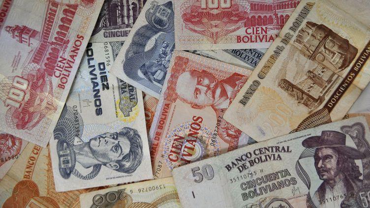 """Les billets boliviens (""""bolivianos"""")sont en train d'être remplacés. (AIZAR RALDES / AFP)"""