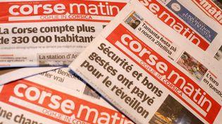 """Des copies de """"Corse-Matin"""" photographiées le 12 février 2019. (PASCAL POCHARD-CASABIANCA / AFP)"""