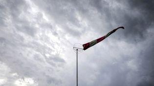 Des vents violents et des pluies diluviennes sont attendues de la Haute-Saône à l'Ardèche. (JEFF PACHOUD / AFP)