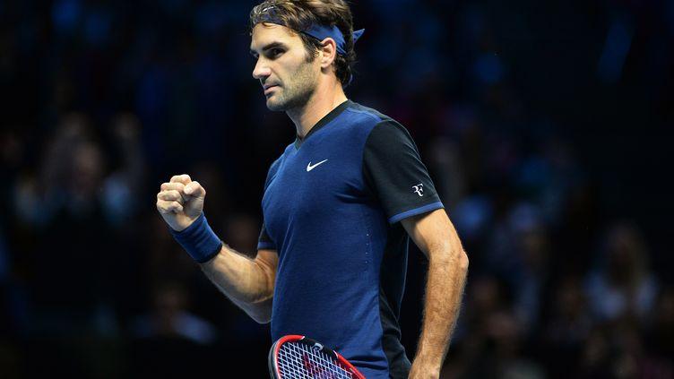 La satisfaction pour Roger Federer (GLYN KIRK / AFP)
