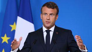 Le président de la République, Emmanuel Macron, lors d'une conférence de presseà l'issue d'une deuxième journée de conseil européen, le 21 juin 2019 à Bruxelles (Belgique). (DURSUN AYDEMIR / ANADOLU AGENCY / AFP)