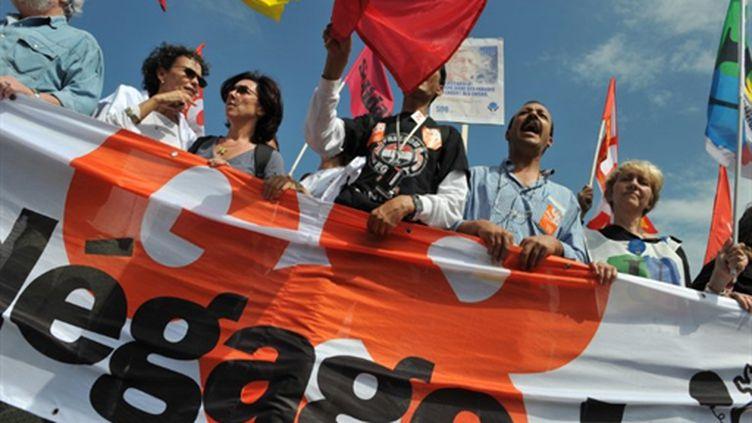 """""""G8 Dégage!"""", mot d'ordre du contre-sommet du G8 qui s'est ouvert samedi 21 mai au Havre (AFP - Alain Jocard)"""