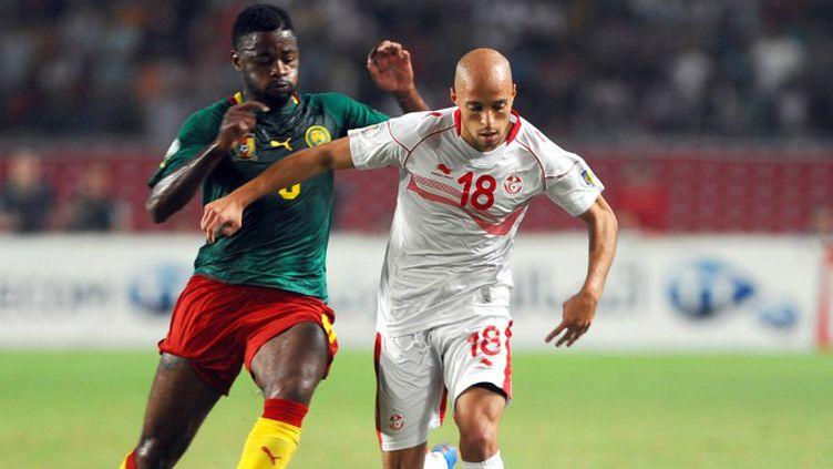 Yassine Mikeri (Tunisie) au duel avec Bilong Song (Cameroun).