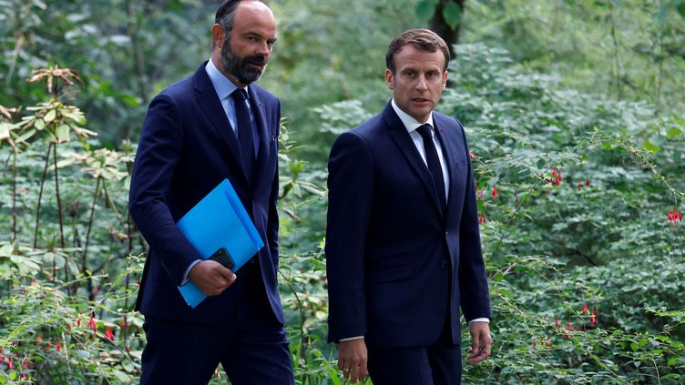 Emmanuel Macron suivi de son Premier ministre, Edouard Philippe, lors de la rencontre avec les membresde la Convention citoyenne pour le climat, le 29 juin 2020, àParis. (CHRISTIAN HARTMANN / AFP)