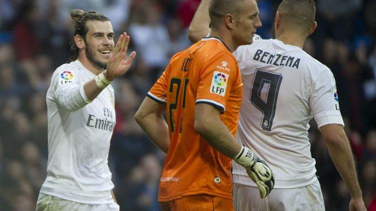 Gareth Bale (à gauche), avec quatre buts inscrits, et Karim Benzema, auteur d'un triplé, ont largement participé à l'humiliation du Real Madrid infligée au Rayo Vallecano (10-2) ! (CURTO DE LA TORRE / AFP)