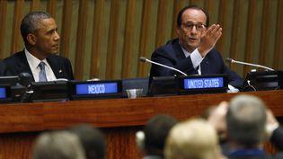 Barack Obama et François Hollande, le 24 septembre 2014 à l'ONU, à New York (Etats-Unis). (KEVIN LAMARQUE / REUTERS)
