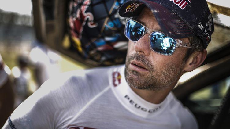 Une chaleur qui n'a visiblement pas l'air d'éprouver Sébastien Loeb, solide leader du Dakar avant la troisième étape. (FRANCOIS FLAMAND / DPPI MEDIA)