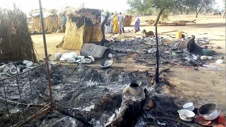 Un village ravagé après une attaque de Boko Haram, près de Maiduguri, le 28 juillet 2019. (AUDU MARTE / AFP)