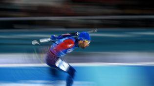 Martin Fourcadeet ses coéquipiers remportent la médaille d'or du relais mixte de biathlon, le 20 février 2018 à Pyeongchang (Corée du Sud). (JONATHAN NACKSTRAND / AFP)