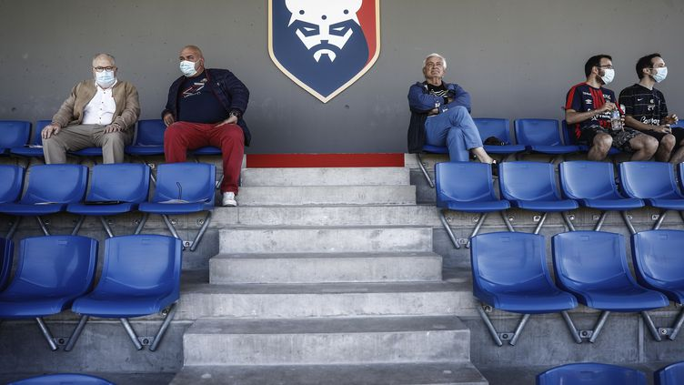 Des supporters du Stade Malherbe de Caen, le 11 juillet 2020 (SAMEER AL-DOUMY / AFP)