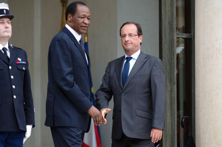 Le président burkinabè Blaise Comparoé aux côtés de François Hollande, le 18 septembre 2012 à l'Elysée (Paris). (BERTRAND LANGLOIS / AFP)