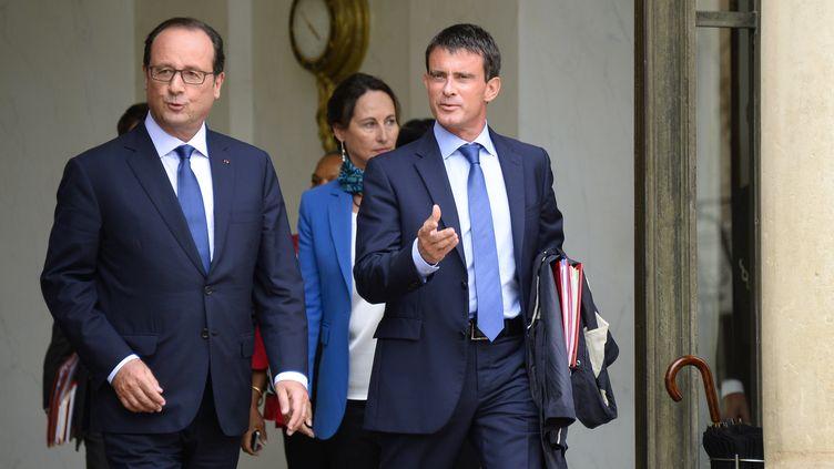 Le président de la République, François Hollande, et le Premier ministre, Manuel Valls, le 27 août 2014 à Paris. (BERTRAND GUAY / AFP)