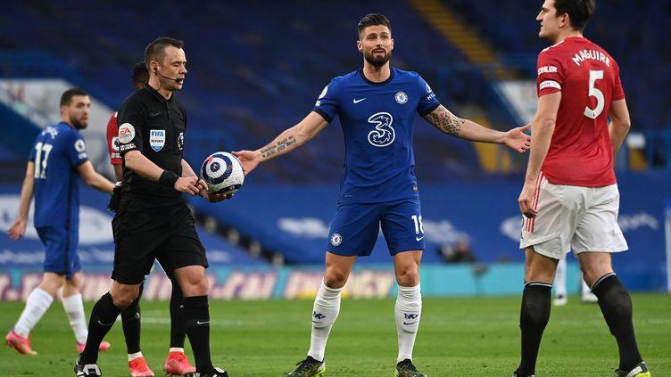 L'attaquant français de Chelsea Olivier Giroud contre Manchester United en Premier League le 28 février 2021. (ANDY RAIN / POOL)