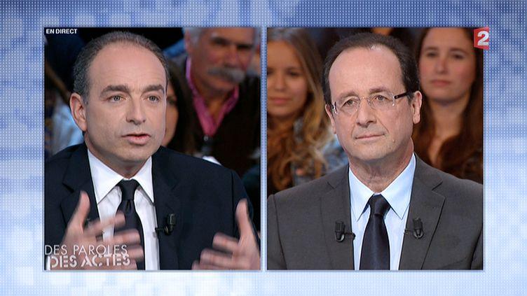 """Jean-François Copé et François Hollande sur le plateau de """"Des paroles et des actes"""", le 15 mars 2012. (FRANCE 2)"""