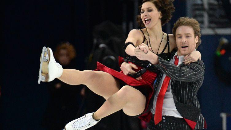 Sotchi (Russie) 16 février 2014,Le couple français Nathalie Péchalat, Fabian Bourzat s'est classé quatrième à l'issue du programme court de l'épreuve de danse de patinage artistique (YURI KADOBNOV / AFP)