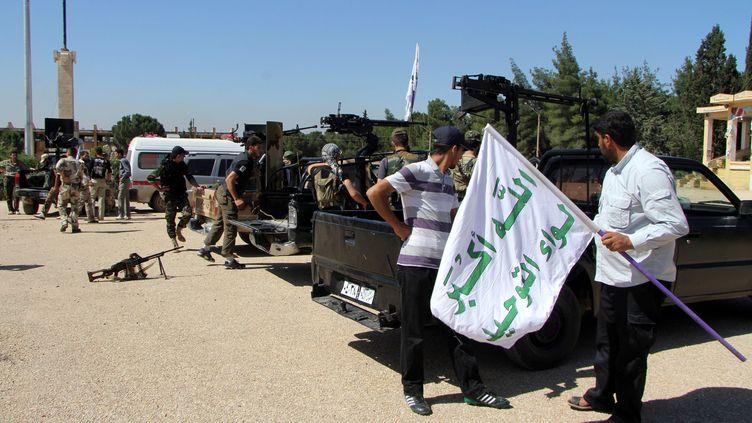 Une brigade d'Alep (Syrie) qui s'apprete à partir pour Al-Quseir aiderlesrebelles contre l'armée régulière (STRINGER / ANADOLU AGENCY)