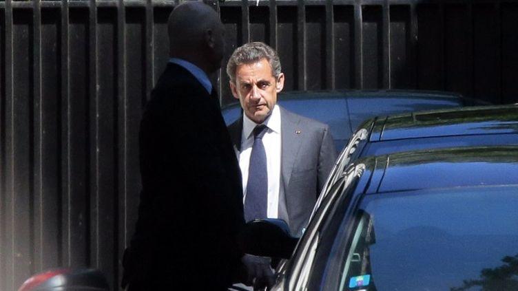 L'ancien président de la République, Nicolas Sarkozy, quitte son domicile, à Paris, mercredi 2 juillet 2014. (JACQUES DEMARTHON / AFP)