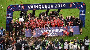 Les joueurs de Rennes célèbrent leur victoire en Coupe de France le 27 avril 2019 au Stade de France. (MARTIN BUREAU / AFP)