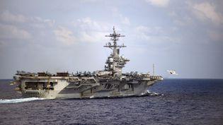 """Le porte-avions nucléaire américain """"USS Theodore Roosevelt"""", dans l'océan Pacifique, le 18 mars 2020. (AFP PHOTO /US NAVY/NICHOLAS V. HUYNH/HANDOUT)"""