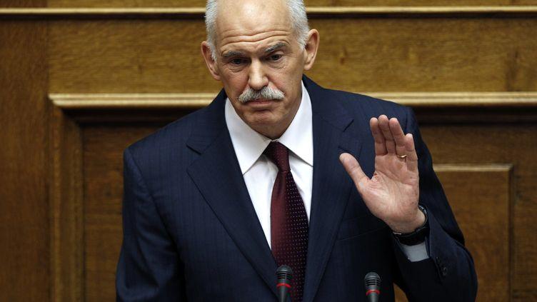 George Papandréoun, le premier ministre grec, juste avant le vote de confiance au parlement grec le 4 novembre 2011. (YIORGOS KARAHALIS/REUTERS)