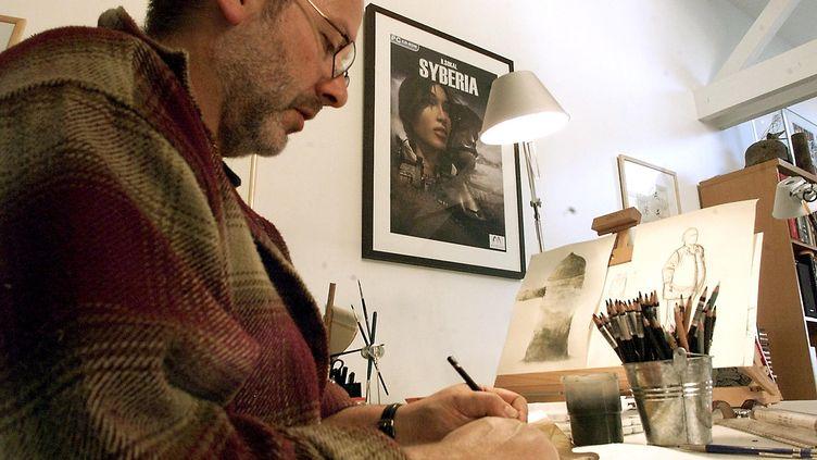 L'auteur de BD et de jeux vidéo belge Benoît Sokal, le 31 mars 2004 à Vitry-lès-Reims (Marne) (FRANCOIS NASCIMBENI / AFP)